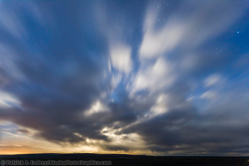 Clouds backlit by a rising moon on the arctic north slope, Alaska.