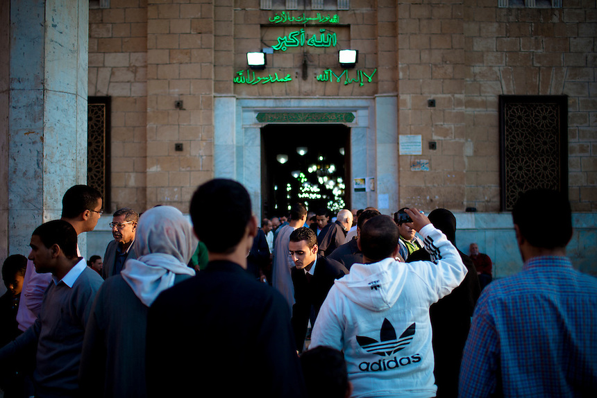Egyptian men gather the entrance of the Hussein Mosque at sunrise on the day of the Eid al Adha feast, November 6, 2011. Photo: Ed Giles.