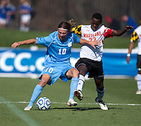 Schillo Tshuma (23) of Maryland fights for the ball with Andy Craven (10) of North Carolina during the game at the Maryland SoccerPlex in Germantown, MD. Maryland defeated North Carolina, 2-1,  to win the ACC men's soccer tournament.