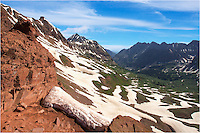 From a small pullout on Gotic Road near Crested Butte, Colorado, you can hike up to West Maroon Pass for a wonderful Colorado landscape looking both at the Crested Butte Area and north towards Aspen. In this image from the Rockies, you can see one of the Maroon Bells, one of Colorado's iconic 14ers. Below, the valley winds around the mountains and down into the Aspen area. You can make the hike all the way to Aspen, camp, then hike back, or arrange for a ride back to your car and make the trek in one day. Either way, the view at the top of this pass in one of the greats in the San Juan Mountain range.