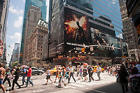 "Advertising for the latest Batman film, ""The Dark Knight Rises"" is seen in Times Square in New York on Tuesday, July 24, 2012. Despite the shooting on opening night in Aurora, CO where James Holmes allegedly shot and killed 12 people, the film broke opening weekend box office records, earning $160,887,295, surpassing its predecessor from 2008. (© Richard B. Levine)"