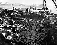 Supplies and equipment are also evacuated from the onslaught of the Communist Forces bearing down on Hungnam, Korea.  December 11, 1950.  Pfc. Emerich M. Christ. (Army)<br /> NARA FILE #:  111-SC-355021<br /> WAR &amp; CONFLICT BOOK #:  1405