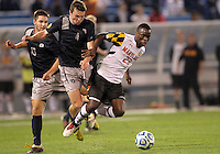 HOOVER, AL - DECEMBER 07, 2012:  Schillo Tshuma (23) of the University of Maryland moves the ball away from Joey Dillon (4) and Tyler Rudy (13) of Georgetown University during an NCAA 2012 Men's College Cup semi-final match, at Regents Park, in Hoover , AL, on Friday, December 07, 2012. The game ended in a 4-4 tie, after overtime Georgetown won on penalty kicks.