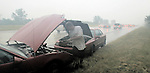 Robert Wagnere, of New Orleans, Louisiana, tries to get his car started on the side of Interstate 10 after it broke down thirty miles north of New Orleans as he was trying to evacuate from the path of Hurricane Katrina August 28, 2005.
