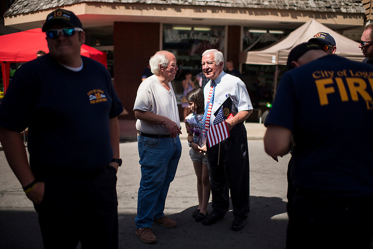 UNITED STATES - JULY 5: Rep. Nick Rahall, D-W.Va., right, speaks with Logan Mayor Serafino Noletti at the West Virginia Freedom Festival in downtown Logan, W. Va., on July 5, 2014. (Photo By Bill Clark/CQ Roll Call)