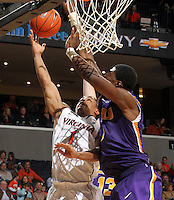Jan. 2, 2011; Charlottesville, VA, USA; Virginia Cavaliers guard Jontel Evans (1) is defended by LSU Tigers forward Malcolm White (5) during the game at the John Paul Jones Arena. Virginia won 64-50. Mandatory Credit: Andrew Shurtleff-