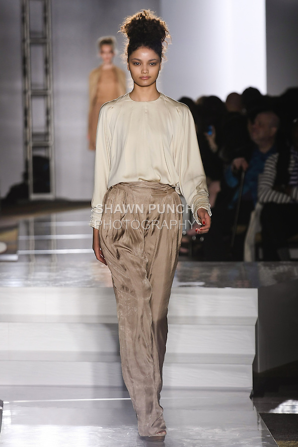 Model walks runway in an outfit by Ally Benaim, for the Parsons 2011 BFA Fashion Show, hosted by Reed Krakoff.