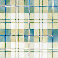 Hamish, a jewel glass mosaic shown in Aquamarine, Quartz, Moonstone, Marcasite, Agate and Chrysocolla, is part of the Plaids and Ginghams Collection by New Ravenna Mosaics.