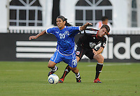 El Salvador National Team midfielder Josue Flores (20) gets fouled by DC United defender Marc Burch (4).  DC United defeated El Salvador National Team 1-0 in a international charity match at RFK Stadium, Saturday June 19, 2010.