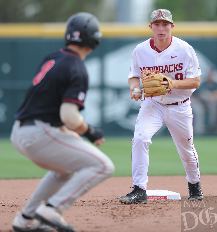 NWA Democrat-Gazette/ANDY SHUPE<br />Arkansas shortstop Jax Biggers (right) prepares to run down Georgia catcher Austin Biggar Saturday, April 15, 2017, after Biggar attempted to advance to third which was occupied during the fourth inning at Baum Stadium in Fayetteville. Visit nwadg.com/photos to see more photographs from the game.