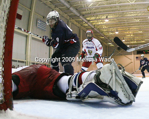 Dmitry Shikin (Russia - 20), Jerry D'Amigo (US - 9), Alexander Burmistrov (Russia - 28) - Team USA defeated Team Russia 6-1 in their second game during the 2009 USA Hockey National Junior Evaluation Camp on Wednesday, August 12, 2009, in the USA (NHL-sized) Rink in Lake Placid, New York.
