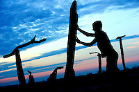 Teenage boys build temporary statues from driftwood on Dauphin Island, Alabama, a barrier island located three miles south of the mouth of Mobile Bay in the Gulf of Mexico. This island, which is approximately 14 miles long and less than two miles wide, appears to have fully recovered from the impact of Hurricane Katrina (2005) and the BP Deepwater Horizon Oil Spill in 2010. Both events greatly reduced tourism income (fewer people came to the island) and local business owners say many establishments went out of business. Today they say they're looking forward to a rebounding tourism business.