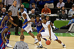 31 MAR 2012:  Darius Miller (1) of the University of Kentucky drives downcourt against Elijah Johnson (15) of the University of Kansas in the championship game of the 2012 NCAA Men's Division I Basketball Championship Final Four held at the Mercedes-Benz Superdome hosted by Tulane University in New Orleans, LA. Kentucky defeated Kansas 67-59 to win the national title. Brett Wilhelm/NCAA Photos