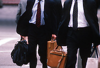 Businessmen walking with luggage