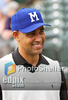 2 March 2003: Montreal Expos General Manager Omar Minaya talks with the media prior to a Spring Training game against the Atlanta Braves at Disney's Wide World of Sports Complex in Orlando, Florida. Mandatory Credit: Ed Wolfstein Photo