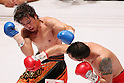 (L to R) Tomonobu Shimizu (JPN),  Hugo Cazares (Mex), AUGUST 31, 2011 - Boxing : Tomonobu Shimizu of Japan in action against Hugo Cazares of Mexico during the WBA Super fly weight title bout at Nippon Budokan, Tokyo, Japan. Tomonobu Shimizu of Japan won the fight on points after twelve rounds. (Photo by Yusuke Nakanishi/AFLO SPORT) [1090]