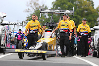 Oct 2, 2016; Mohnton, PA, USA; Crew members with NHRA top fuel driver Doug Kalitta during the Dodge Nationals at Maple Grove Raceway. Mandatory Credit: Mark J. Rebilas-USA TODAY Sports