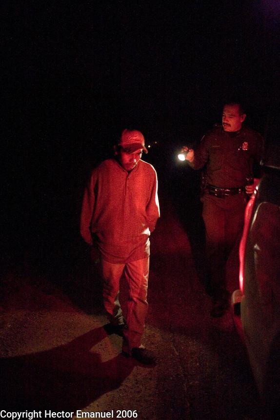 Border Patrol agent Luis Chavez apprehends a suspected drug smuggler..Nogales, AZ.12/10/05.photos: Hector Emanuel