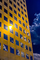 Clouds reflecting into a gold colored building, Downtown Denver, Colorado USA