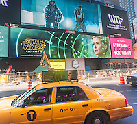 Advertising for J.J. Abrams' Star Wars: The Force Awakens, which will premiere in two weeks, on a giant LED screen in Times Square in New York on Friday, December 4, 2015. With the release of numerous trailers, licensed merchandise and now in-your-face advertising the Disney Co. promotional juggernaut is amping up for the blockbuster release.(© Richard B. Levine)