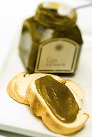Slices of bread spread with Bronte pistachio paste by chef Corrado Assenza