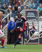 New England Revolution midfielder Shalrie Joseph (21) clears the ball. In a Major League Soccer (MLS) match, the New England Revolution defeated Portland Timbers, 1-0, at Gillette Stadium on March 24, 2012