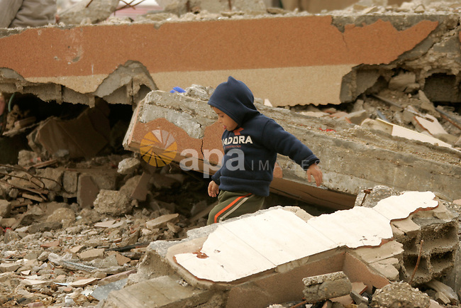 Palestinian child walks on the rubble of a house which was destroyed by Israeli warplanes during the war of 22 days on Gaza, in Rafah, southern Gaza Strip on 25 February 2010.United Nations human rights chief Navi Pillay defended on Wednesday the controversial Goldstone investigation into Israel's 2008-2009 military assault in Gaza, saying both its methods and conclusions were sound. Photo by Abed Rahim Khatib