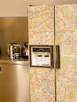 An American-style fridge in a contemporary kitchen has been customized with a map of London.