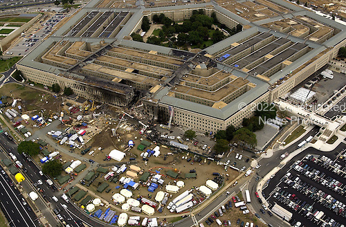 Federal Bureau of Investigation (FBI) agents, fire fighters, rescue workers and engineers work at the Pentagon crash site on Friday, September 14, 2001, where a high-jacked American Airlines flight slammed into the building on September 11, 2001.  The terrorist attack caused extensive damage to the west face of the building and followed similar attacks on the twin towers of the World Trade Center in New York City.  .Credit: Department of Defense via CNP