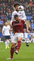 Bolton Wanderers' Derik Osede beats Northampton Town's Marc Richards in the air<br /> <br /> Photographer Alex Dodd/CameraSport<br /> <br /> The EFL Sky Bet League One - Bolton Wanderers v Northampton Town - Saturday 18th March 2017 - Macron Stadium - Bolton<br /> <br /> World Copyright &copy; 2017 CameraSport. All rights reserved. 43 Linden Ave. Countesthorpe. Leicester. England. LE8 5PG - Tel: +44 (0) 116 277 4147 - admin@camerasport.com - www.camerasport.com