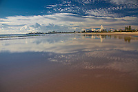 Clouds over Coolangatta are refelected in the low tide conditions along North Kirra Beach, Queensland, Australia. Photo: joliphotos.com