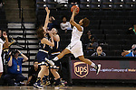 18 February 2016: Wake Forest's Ariel Stephenson (right) shoots over Notre Dame's Hannah Huffman (24) and Madison Cable (left). The Wake Forest University Demon Deacons hosted the University of Notre Dame Fighting Irish at Lawrence Joel Veterans Memorial Coliseum in Winston-Salem, North Carolina in a 2015-16 NCAA Division I Women's Basketball game. Notre Dame won the game 86-52.