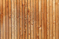 A close up of the pine cladding which is a feature of the interior and exterior walls of this modern house