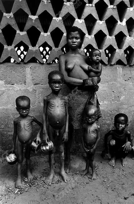 Biafran family waiting for food distribution, Biafra, Nigeria, 1969