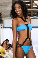 Model walks runway in an AdianiC Spring 2013 swimsuit by Adisa Imani Christopher, during the JRG Bikini Under The Bridge 2012 fashion show on July 9, 2012.