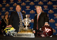 Michigan head coach Brady Hoke and Virginia Tech Frank Beamer pose together with the Sugar Bowl trophy for group photos during Head Coaches Press Conference at Marriott Hotel at the Convention Center on January 2nd, 2012.