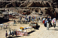 Jordan. Petra. The archeological site is part of the UNESCO world heritage project.  The Nabataeans were an arabian industrious tribe which settled down in southern Jordan 2000 years ago. Petra is located at the bottom of a spectacular deep gorge surrounded by mountains. Small open-air shop sells souvenirs, drinks, films and various objects to tourists.  © 2002 Didier Ruef