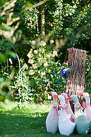 A gaggle of geese made of fabric add a touch of humour to the garden