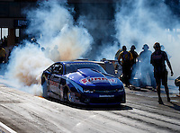 Jul 8, 2016; Joliet, IL, USA; NHRA pro stock driver Jason Line does a burnout during qualifying for the Route 66 Nationals at Route 66 Raceway. Mandatory Credit: Mark J. Rebilas-USA TODAY Sports