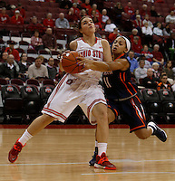 Ohio State Buckeyes guard Cait Craft (13) gets fouled buy Tennessee Martin Skyhawks guard Heather Butler (11) at Value City Arena in Columbus Dec. 17, 2013.(Dispatch photo by Eric Albrecht)