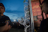 A train mounted section is taken to the border on the railway to close down the last few meters of the fence on the border between Serbia and Hungary near Roszke (about 174 km South of capital city Budapest), Hungary on September 14, 2015. ATTILA VOLGYI