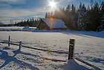 Idaho, Northern, Bonner County, Sagle.  A barn and old truck in a winter landscape.