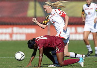 COLLEGE PARK, MD - OCTOBER 21, 2012:  Ashley Spivey (8) of the University of Maryland tackles Tiffany McCarty (14) of Florida State during an ACC women's match at Ludwig Field in College Park, MD. on October 21. Florida won 1-0.