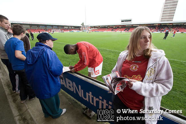 Fans of Crewe Alexandra outside on the main stand collecting autographs from Crewe Alexandra players as they warm up prior to their League 2 fixture against Aldershot Town at the Alexandra Stadium. The visitors won by 2 goals to 1.