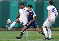 HYATTSVILLE, MD - OCTOBER 26, 2012:  Sean Cowdrey (10) of DeMatha Catholic High School is pushed by Arjan Ganji (10) of St. Albans during a match at Heurich Field in Hyattsville, MD. on October 26. DeMatha won 2-0.