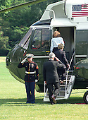 United States President Bill Clinton salutes the Marine Guard as he and first lady Hillary Rodham Clinton and Chelsea Clinton board Marine 1 on the South Lawn of the White House on August 19, 1999.  The Clintons are to vacation for 2 weeks in Martha's Vineyard.  From top to bottom: Chelsea Clinton, Mrs. Clinton, President Clinton. On Tuesday, August 17, 1999, the President testified before the Grand Jury on his involvement in the Monica Lewinsky scandal and subsequently made a nationally televised statement admitting he had an inappropriate relationship with Ms. Lewinsky.<br /> Credit: Ron Sachs / CNP