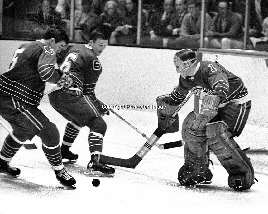 Seals action (1968 photo) Carol Vadnais, Bryan Watson and goalie Charlie Hodge..(photo/Ron Riesterer)