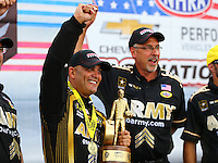 Sep 5, 2016; Clermont, IN, USA; NHRA top fuel driver Tony Schumacher (left) celebrates with crew chief Mike Green after winning the US Nationals at Lucas Oil Raceway. Mandatory Credit: Mark J. Rebilas-USA TODAY Sports