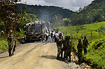 Guerrillas members of the National Liberation Army (ELN) attack a bus in Colombia's routes