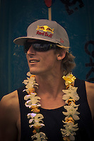 HALEIWA, HI (Thursday Dec. 3, 2009) Bruce Irons (HAW) The opening ceremony of the Quiksilver in Memory of Eddie Aikau was held today at Waimea Bay. This year's event is the 25th Anniversary  and will be held on one day , between December 1, 2009 and February 28, 2010, when the waves eceed the  20 foot  minimum threshold and the 28 invitees will compete for the $98.000 prize purse...The northern hemisphere winter months on the North Shore signal a concentration of surfing activity with some of the best surfers in the world taking advantage of swells originating in the stormy Northern Pacific. Notable North Shore spots include Waimea Bay, Off The Wall, Backdoor, Log Cabins, Rockpiles and Sunset Beach... Ehukai Beach is more  commonly known as Pipeline and is the most notable surfing spot on the North Shore. It is considered a prime spot for competitions due to its close proximity to the beach, giving spectators, judges, and photographers a great view...The North Shore is considered to be one the surfing world's must see locations and every December hosts three competitions, which make up the Triple Crown of Surfing. The three men's competitions are the Reef Hawaiian Pro at Haleiwa, the O'Neill World Cup of Surfing at Sunset Beach, and the Billabong Pipeline Masters. The three women's competitions are the Reef Hawaiian Pro at Haleiwa, the Gidget Pro at Sunset Beach, and the Billabong Pro on the neighboring island of Maui...Photo: Joliphotos.com